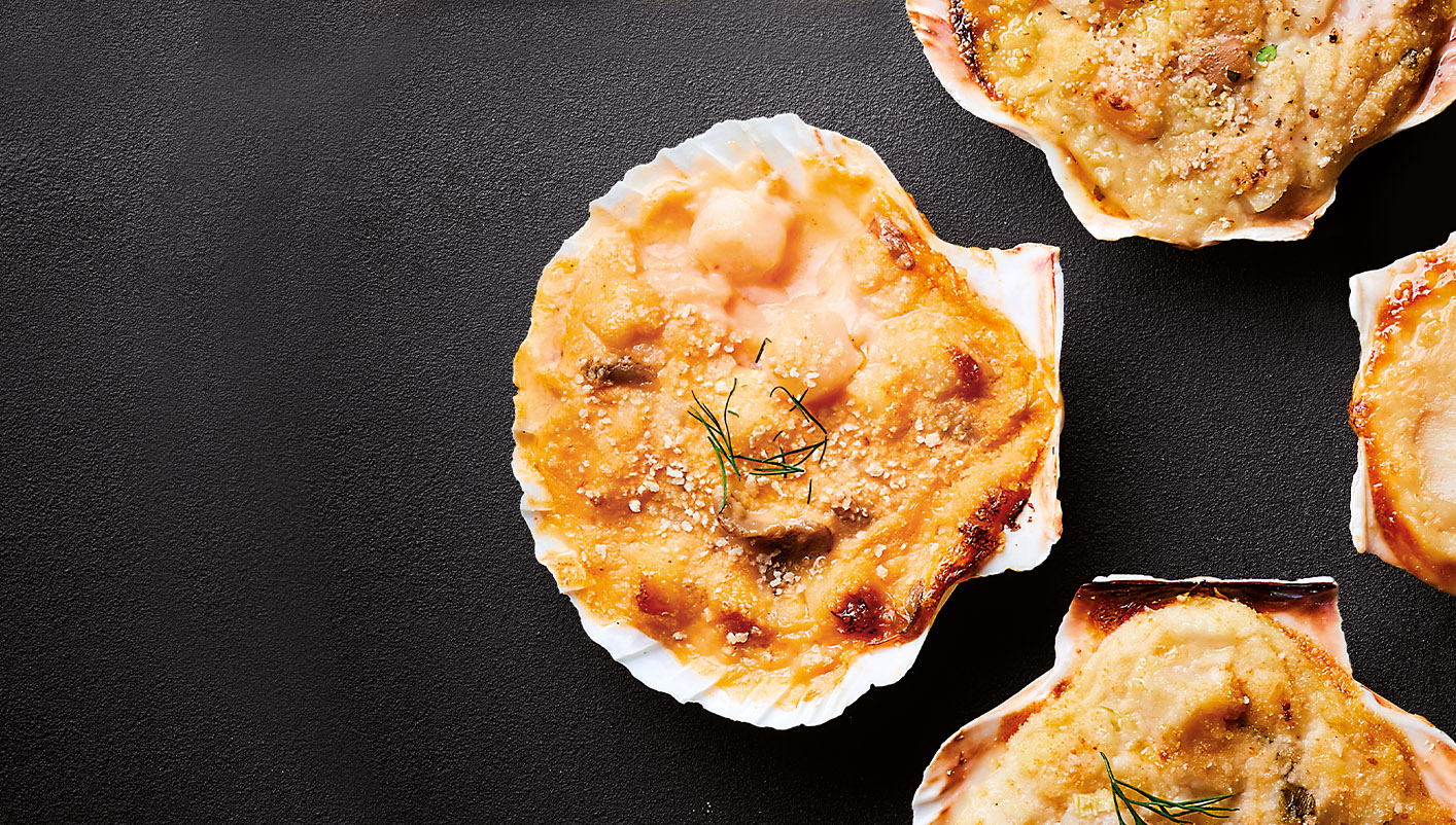 4 Coquilles St-Jacques* sauce Cognac F. Champagne